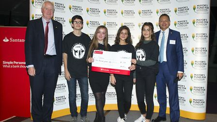 The young people from Shpresa receive their cheque (Picture: Ben Stevens/i-Images)