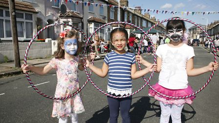 Maria, 5, Alicia, 5, and Tessa 8, enjoy the Morley Road street party in Stratford Picture: Sandra