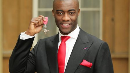 Tim Campbell holds his Member of the British Empire (MBE) medal. Picture: Yui Mok/ PA Images