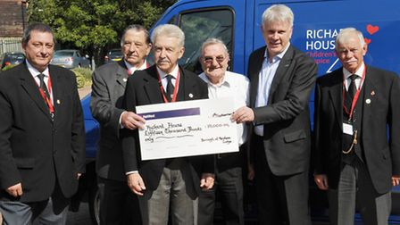 Lodge members and Peter Ellis with the cheque