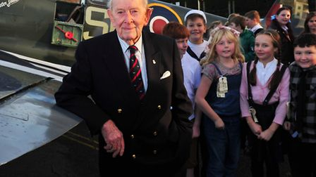 Meadow Primary school children get the chance to talk to Tony Cooper a WWII pilot and look at a Repl