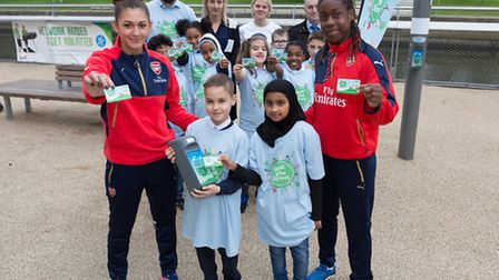 Pupils and teacher from Manor Primary with England and Arsenal footballers, Vyan Sampson and Jade Ba
