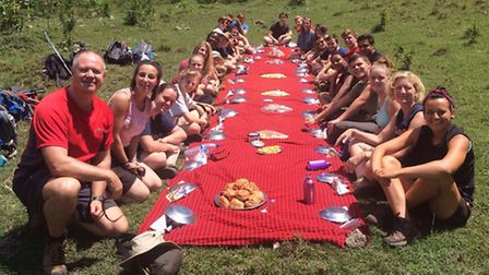 West Hatch High School pupils and staff enjoy lunch during their trip in Africa