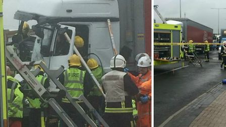 Firefighters cut the lorry driver out (left)