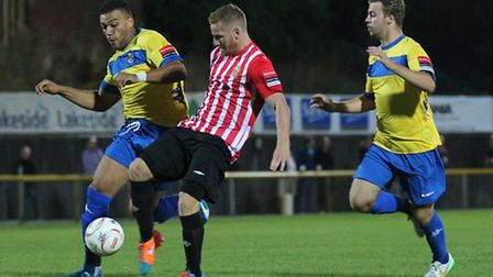 Nathan Cooper (right) tries to thwart now Hornchurch team mate David Knight for Romford earlier this