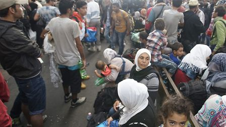 Migrants wait at a railway station in Budapest, Hungary. Picture: Zoltan Balogh/MTI via AP/PA Images