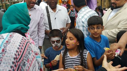 Youngsters help organise street party in Forest Gate by delivering letters