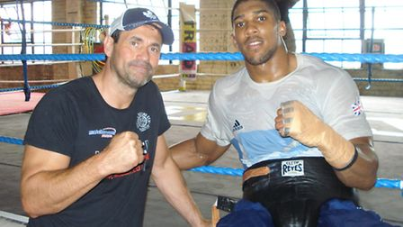 Anthony Joshua pictured with trainer Tony Sims after a workout at Newham's TKO gym