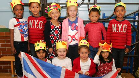 Pupils from Crowlands Primary school holding a tea party for the whole school to celebrate the Queen