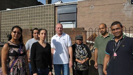 Naila Mir, third from left, with residents at the site of the new East Road mosque