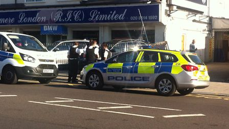 Police attending the scene in High Road, Ilford.