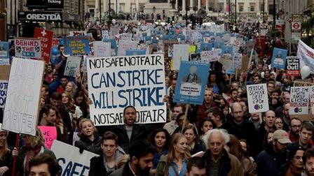 Demonstrators march down Whitehall during the 'Let's Save the NHS' rally and protest march by junior