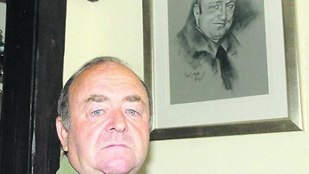 Les Balkwell with a picture of his son Lee, who was found dead in a cement mixer in 2002