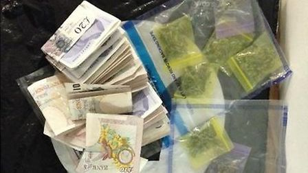 The drugs and money seized during the arrest Photo: @MPSNewham