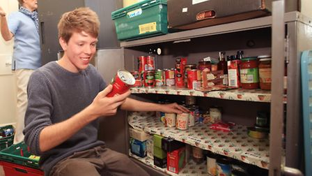 Bill Allgood check the cans at the storage of the Newham foodbank in Bonny Downs Church Hall.