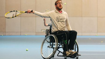 Reporter Mark Shales trying out wheelchair tennis at the Lee Valley Hockey and Tennis Centre