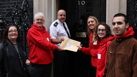 Members of Caritas Anchor House hand in petition to Downing Street