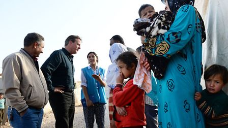 Prime Minister David Cameron meets Syrian refugee families at a tented settlement camp in the Bekaa