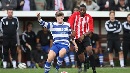 Justus Paliulis of Ilford and Roddy Lemba of Clapton battle for possession (pic: George Phillipou/TG