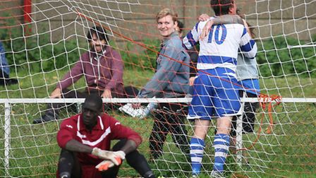 Ilford's Chris Stevens (10) celebrates netting his side's second goal at Clapton, as home keeper Pap