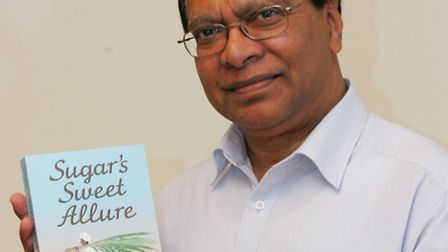Khalil Rahman Ali with the book he has had published