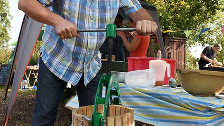 """Noel Cottrell apple pressing at Forest Farm Peace Garden's """"Abundance Day"""". Picture: Ken Mears"""