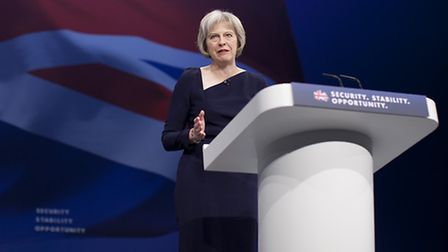 Secretary of State for Home Affairs Theresa May delivers her speech to delegates in the third day of