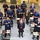 Principle of Newham College, Di Gowland, (centre) with students and staff in a construction class wh