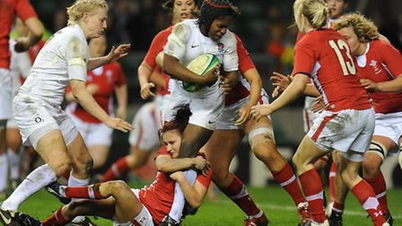 England's Margaret Alphonsi is tackled by Wales' Rosie Fletcher (pic: Tony Marshall/EMPICS)