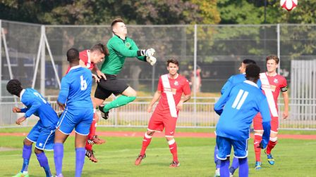 Sporting Bengal keeper Lewis Lockyer punches clear against Halstead (pic: Tim Edwards)
