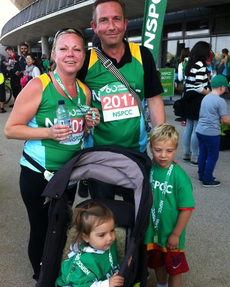 John and Steph Sykes ran with children Josh, five, and Isla, one