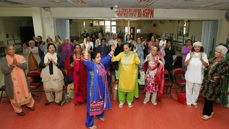 Retired GP and yoga teacher Sudarshan Kapur, holding a yoga/singing/dancing event. at the Panjabi Ce