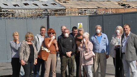 Angry residents outside the fire damaged plant