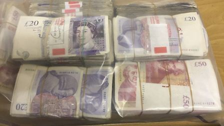 Cash recovered after police raids arrested fraudsters who had conned banking customers out of £60mil