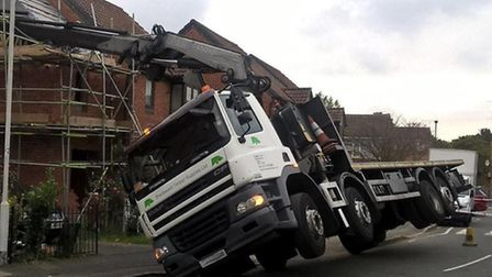 Lorry collides with house in Plaistow (Picture: @LondonFire)
