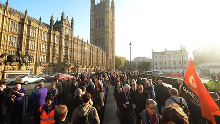 TUC members queue outside the Houses of Parliament to lobby against the Trade Union Bill Photo