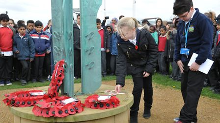 Children remember pilots who died in the First and Second World Wars at Fairlop Waters Country Park