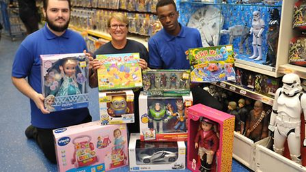 Sonnie Dolan, Paula Blake and Shaq Noel with toys for the appeal