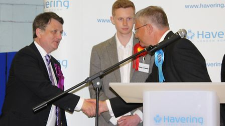Andrew Rosindell (Ukip) shakes hands with second place Gerard Batten (Ukip) after winning the Romfor