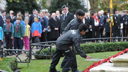 Youngsters lay wreathes at the Remembrances service in Central Park