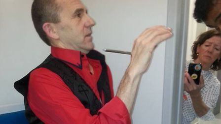 Magician Kyle Wallace impaled his hand with 6 inch nail