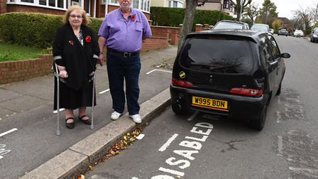 David and Shirley Miller are angered by a car being left abandoned in the disabled parking bay outsi