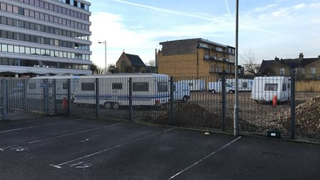 Travellers set up at building site in High Road, Ilford