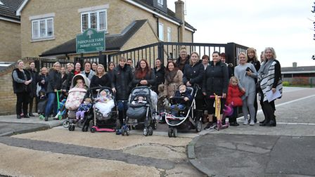 Parents gathered outside Parsonage Farm Primary School on Tuesday to express their concerns about th