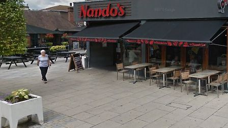 The car smashed through the plant pot and into the front of the building. Picture: Google Maps