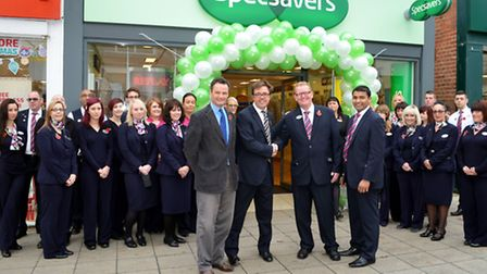 David Holcombe, store director at Specsavers Lowestoft, Waveney MP Peter Aldous, John Perkins joint