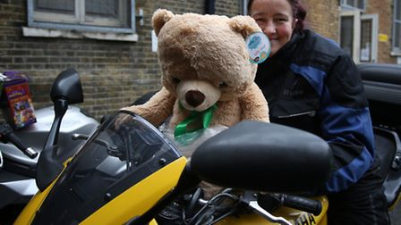 Biker Carolyn Dodds lets teddy take the lead for the toy appeal