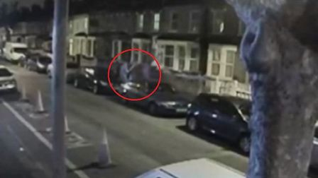 Two men attack the victim, now on the ground, with a baseball bat. Picture: MPS