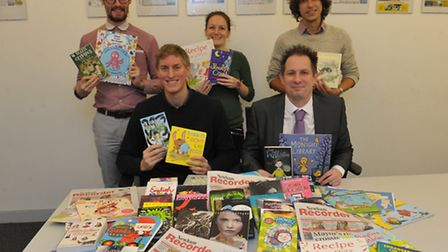 Recorder staff with the book donation for the toy appeal