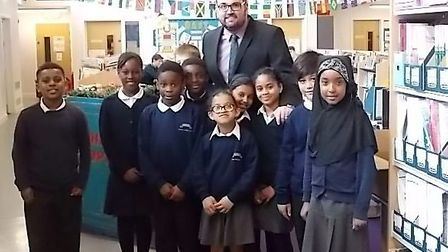 Paul Harris with pupils from Curwen Primary School